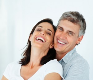couple embracing, smiling.