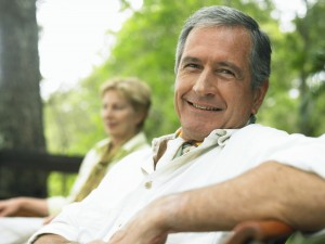 mature man relaxing on park bench.