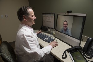 Using the telemedicine capabilities of Mercy Hospital in St. Louis, Gilbert Webb, M.D., conducts a consultation with a patient at a remote location.