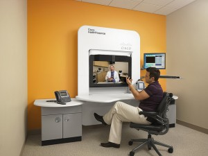 A patient interacts remotely with a physician using Cisco's HealthPresence telemedicine mobile clinic.