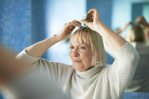 Some women experiencing hair loss find that topical scalp solutions such as minoxidil can help them hold on to the hair they have and even regrow some of the hair they've lost.