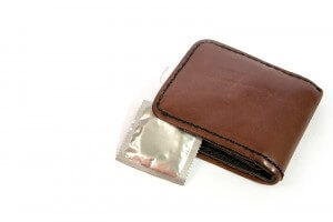 Carrying around a condom in your wallet may not be the best idea.