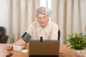 In this asynchronous telemedicine transaction, a patient records her blood pressure data, which is then transmitted to her doctor to evaluate at a later time.