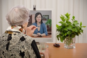 In this synchronous telemedicine transaction, a patient consults with her doctor via videoconferencing technology.