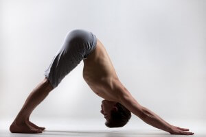 Some yoga poses, including downward dog, help to strengthen the spine.