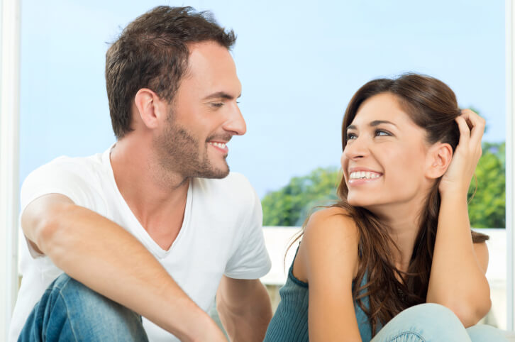 couple smiling and talking