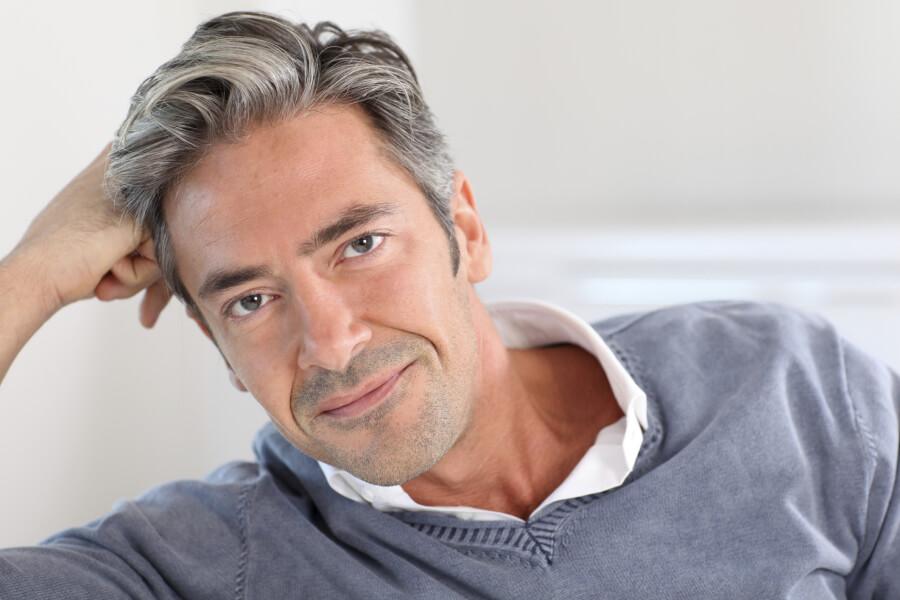 mid adult man sitting on sofa, portrait