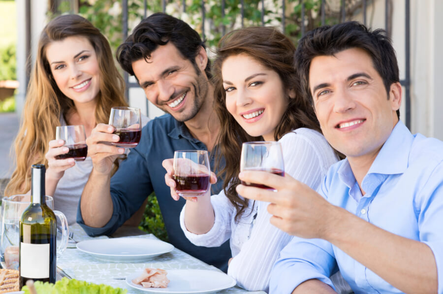 group of friends raising wine glasses