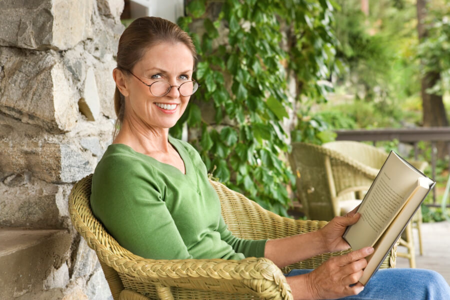 woman sitting on porch, reading
