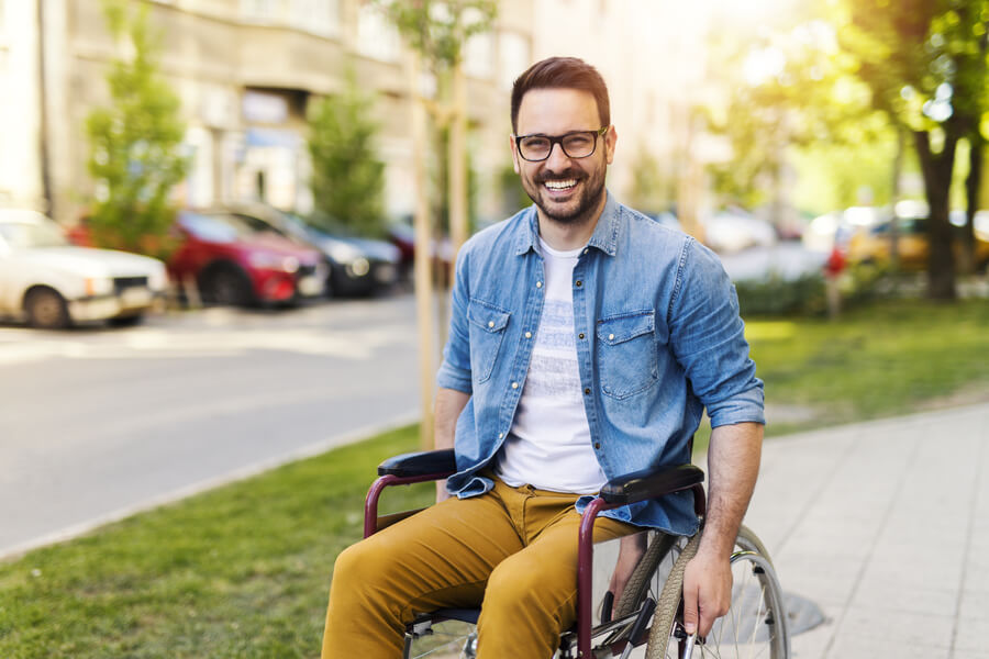 Smiling man in a wheelchair