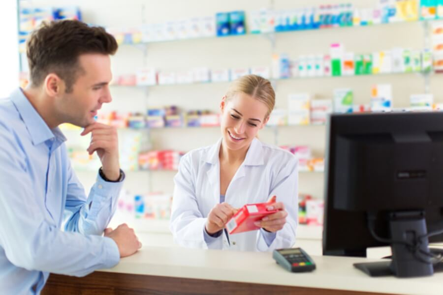 Man consulting a pharmacist.