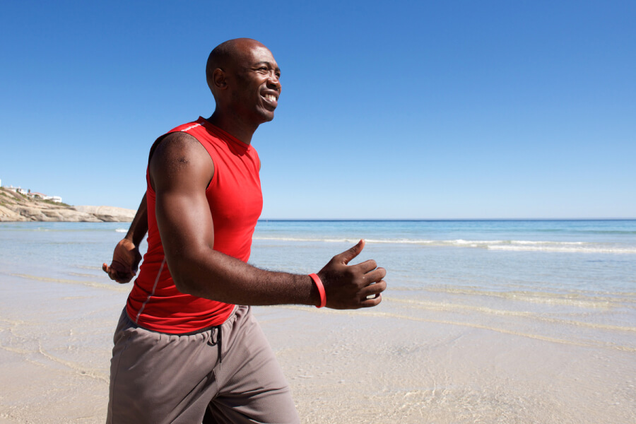 Man running on a beach.