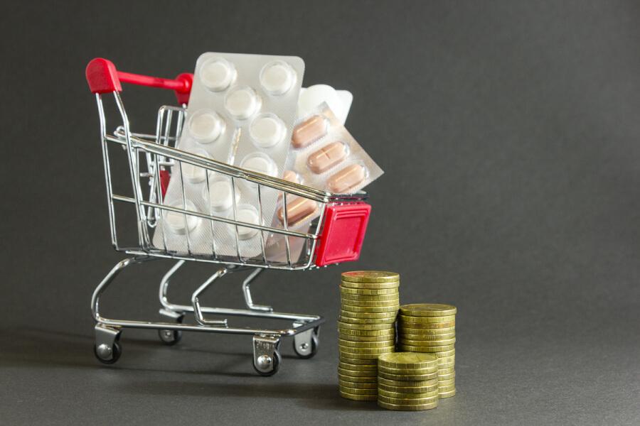Miniature shopping cart with pills.