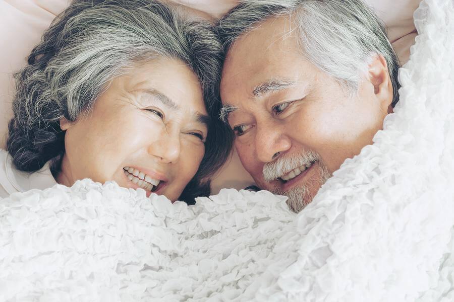 Older couple smiling together.