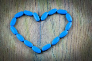 Viagra pills formed into a heart.