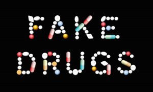 The words fake drugs spelled out with pills.
