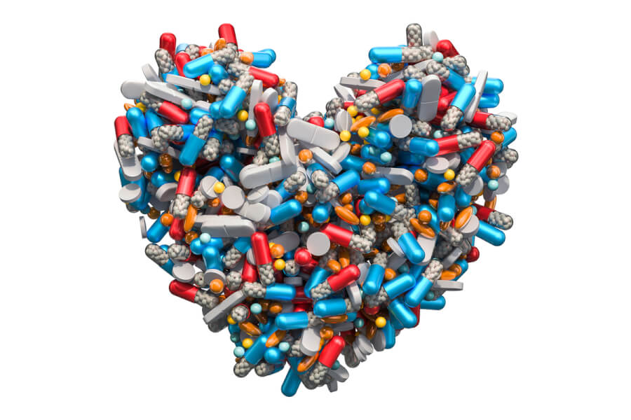 Pile of pills forming a heart shape.