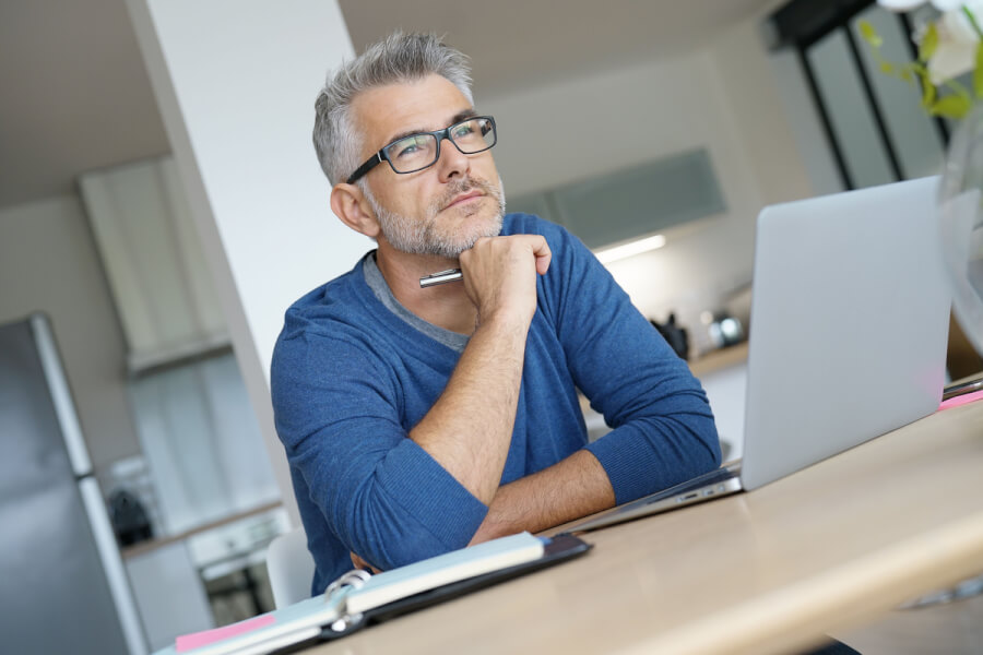 Man sitting in front of his laptop computer.