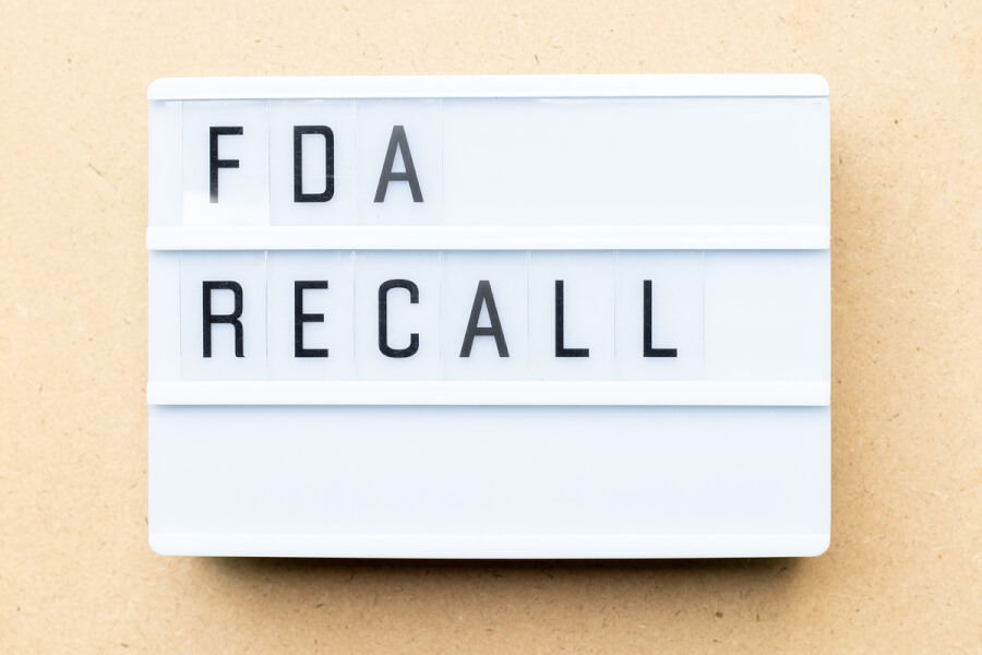 FDA recall words on a white sign.