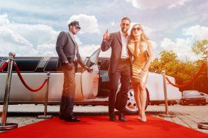 Movie stars walking a red carpet.