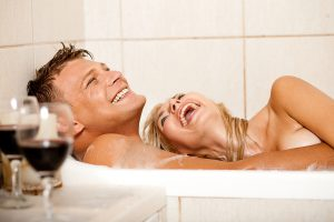 Happy couple in a tub together.