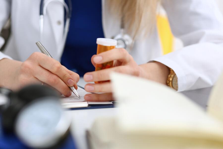 Medical doctor writing a prescription.