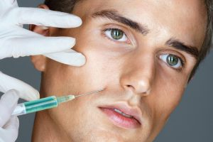Man receiving botox to his upper lip area.