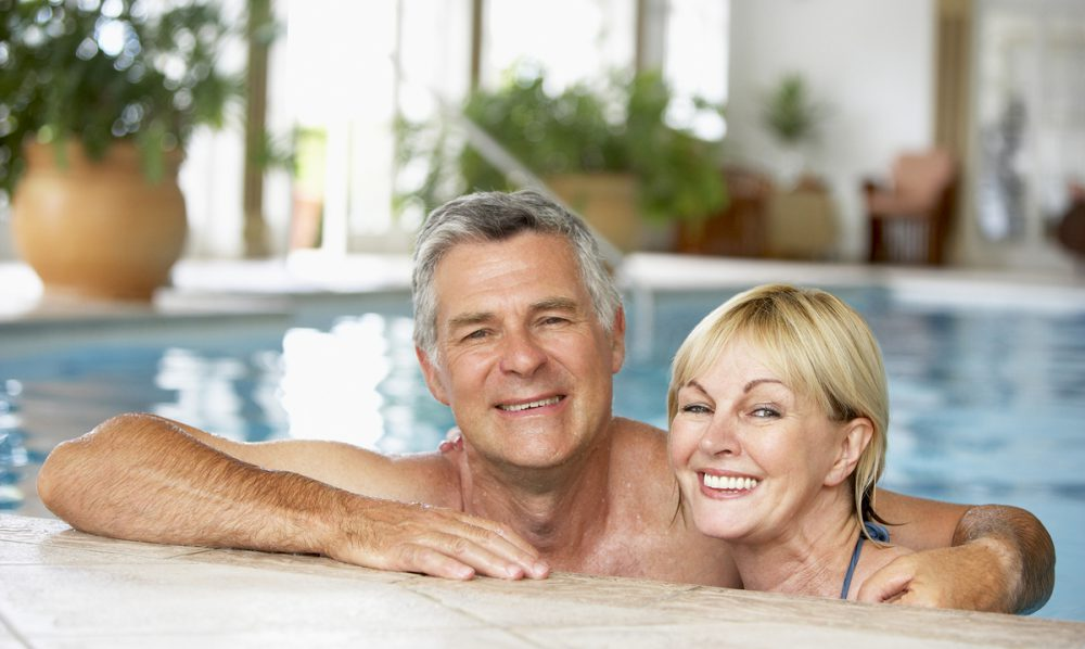 Happy couple in a pool together.