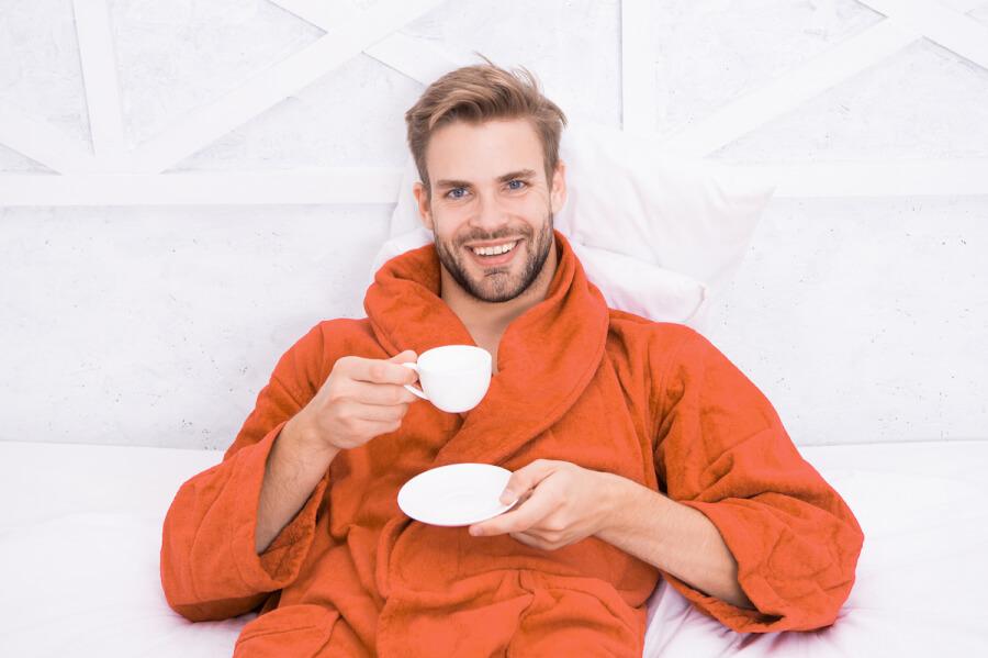 Man sitting down drinking coffee.