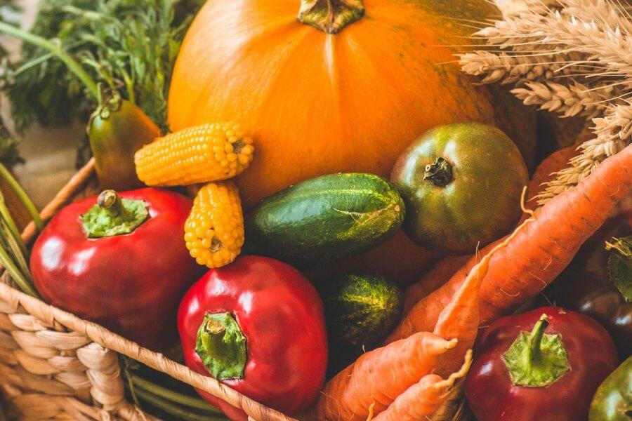 Basket filled with fresh vegetables.