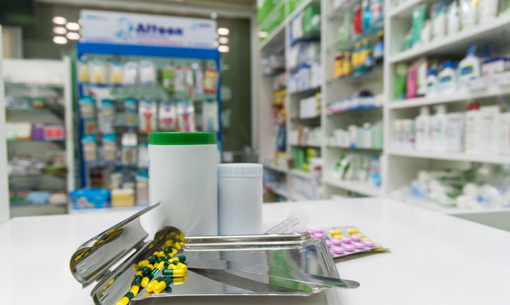 Pharmacy with pill packs on a counter.