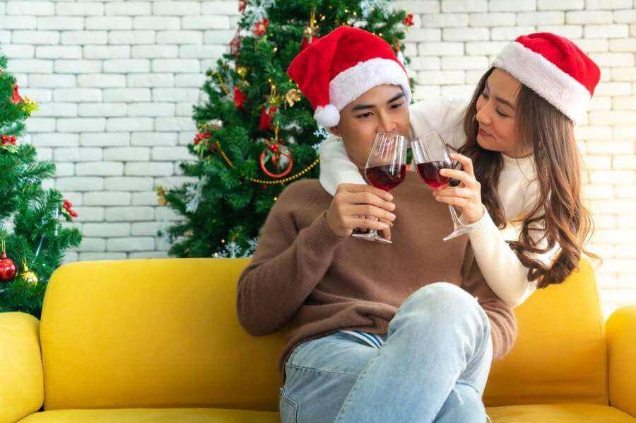 Happy couple with Santa hats.