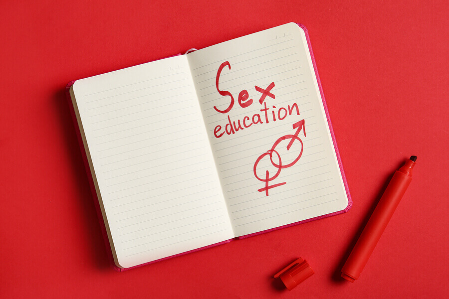 Notebook with the words sex education written in red.