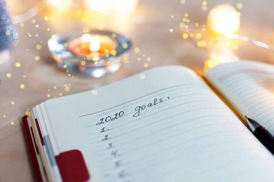 2020 goals written in a notebook.