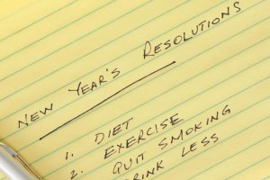 Notebook with New Year's Resolutions listed.