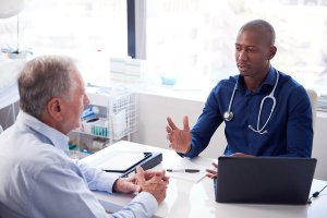 Man having a discussion with a medical doctor.