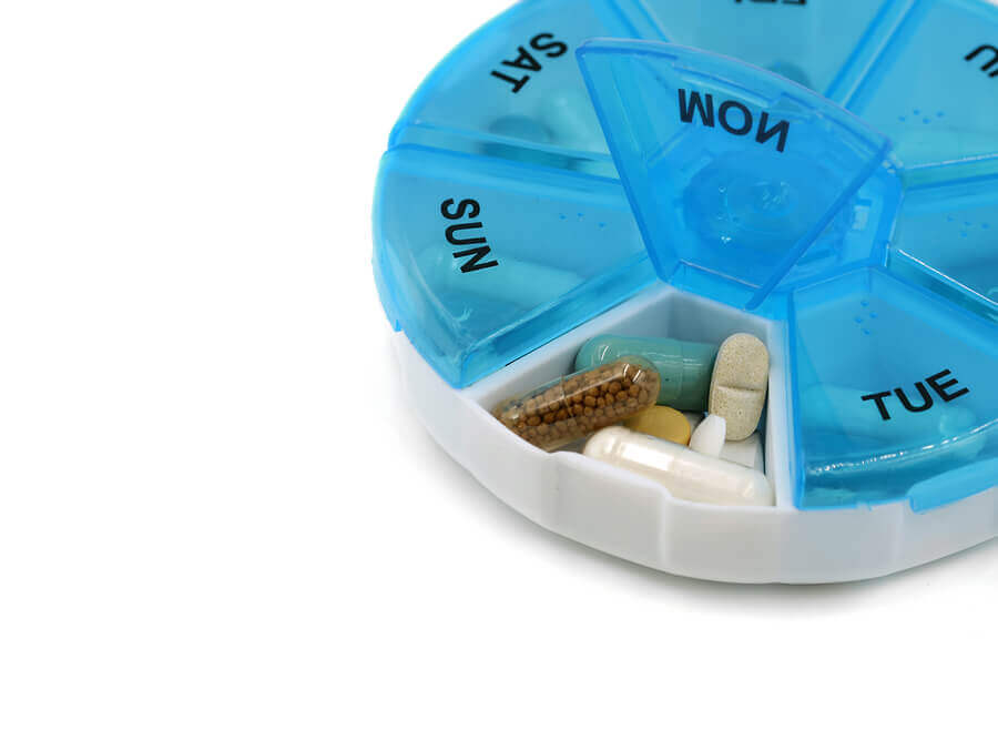 Round pill container for seven days a week