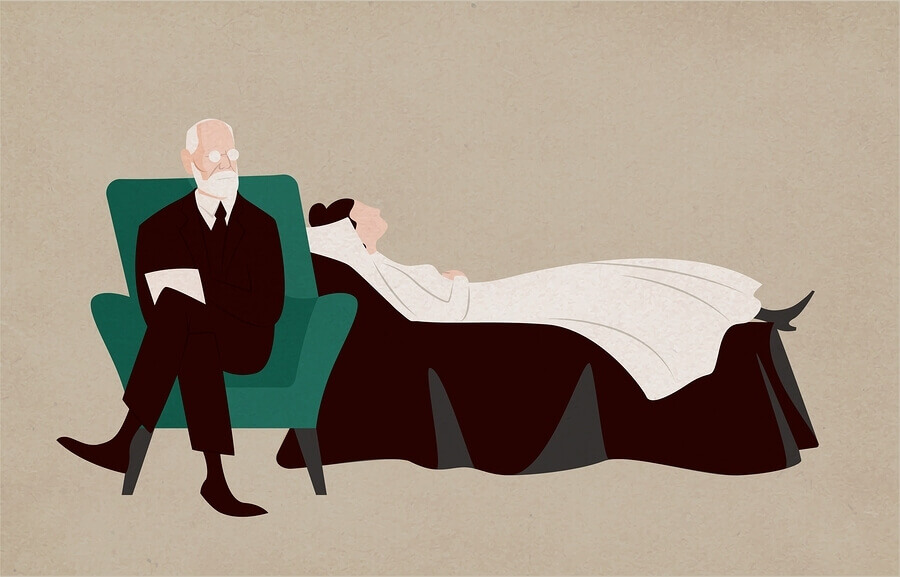 Psychiatrist treating a patient while they lay on a couch.