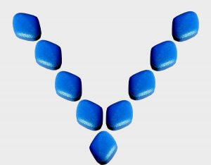 Blue pills formed in the shape of a v.