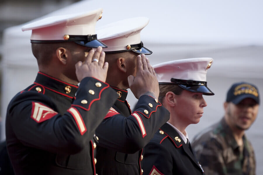 Group of Marines saluting.