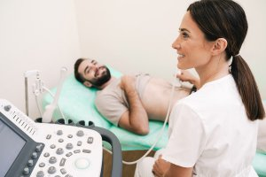 Man getting an ultrasound on his abdomen.