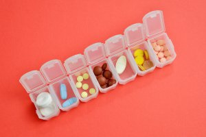 Weekly pill box filled with medication.