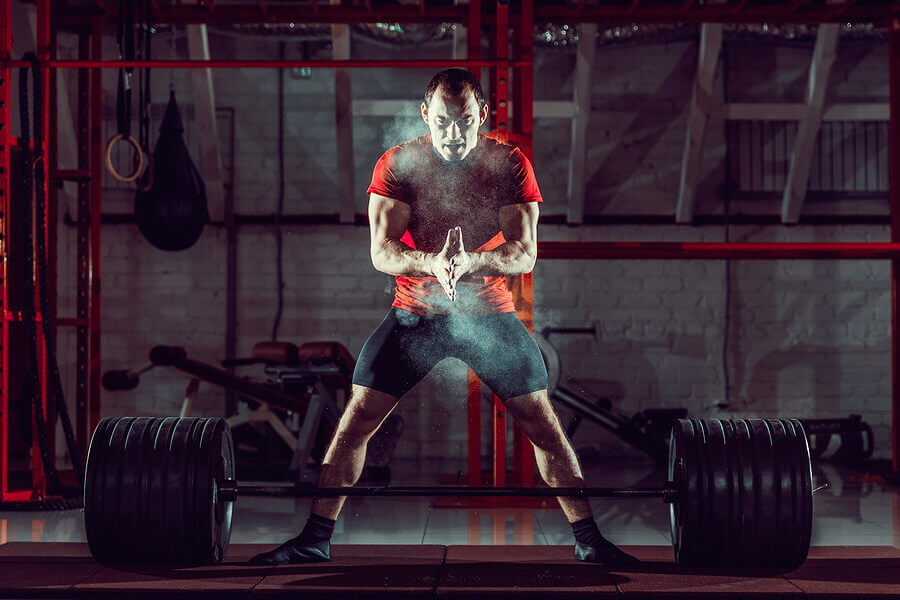 Man getting ready to lift a barbell.