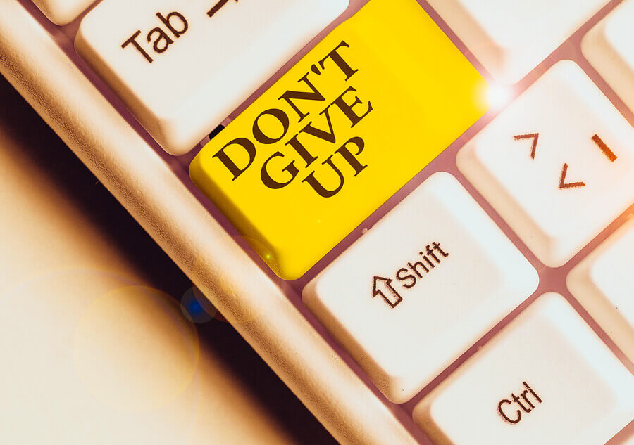Keyboard enter key labeled don't give up.