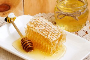 Honey comb and jar of honey