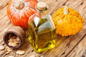 Pumpkin oil and pumpkins.