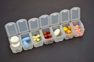 Weekly pill pack filled with medications.