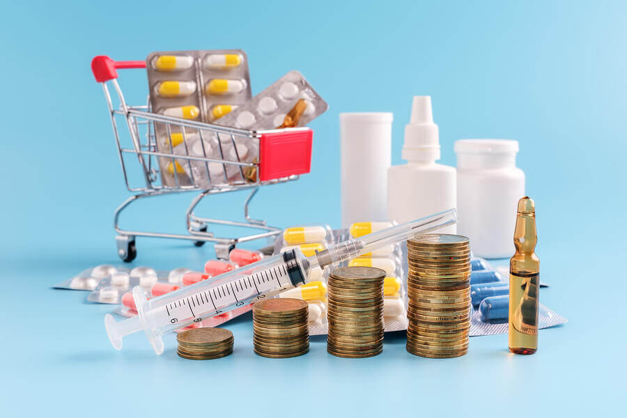 Miniature shopping cart, and medication bottles.