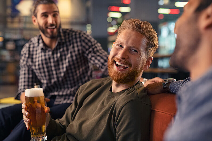 Smiling group drinking beer.