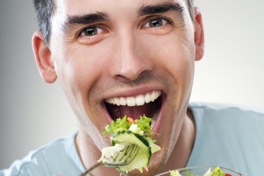 Man eating a salad.